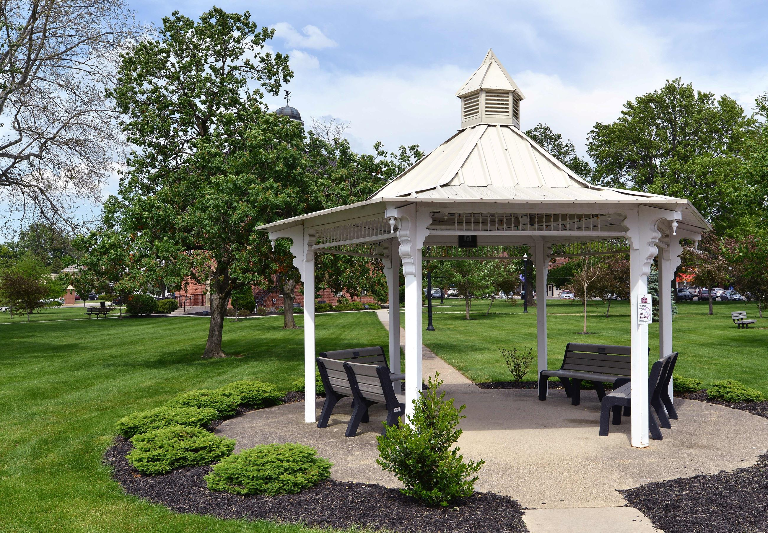 An outside view of town hall grounds and white gazebo