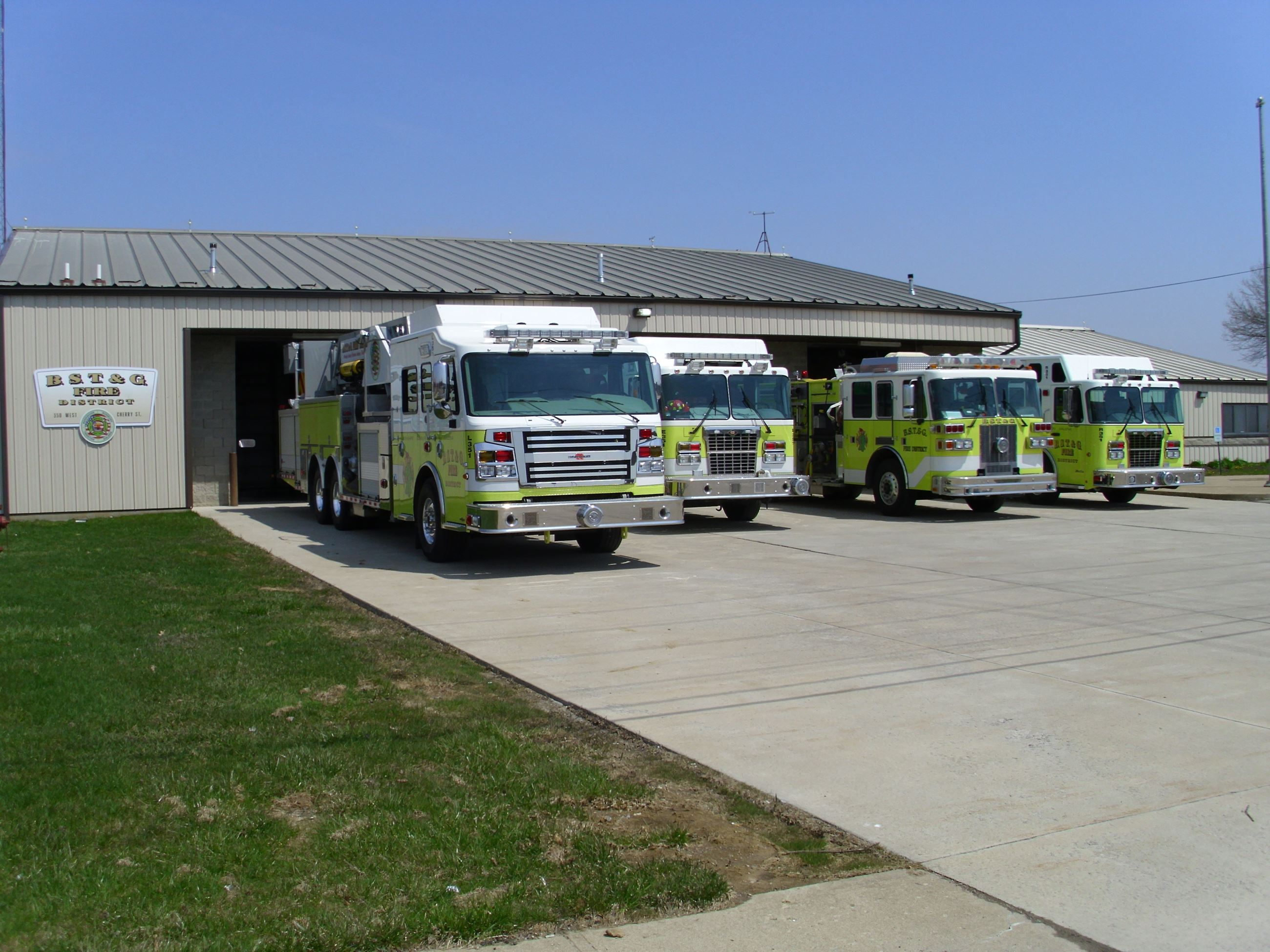 The BSTG Fire Station with four fire trucks lined up outside